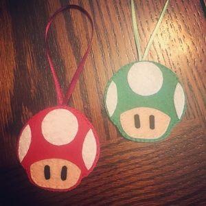 A pair of Mario Bros Mushrooms Hanging Decor